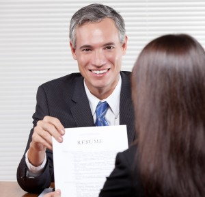 Man proudly shows his resume during a job interview